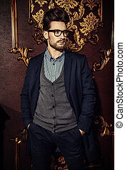 imposing intelligent - Portrait of a well-dressed imposing...