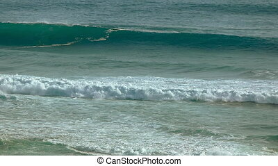 Breakers Rolling over a Tropical Beach. - Ocean waves and...