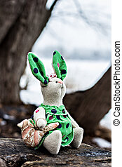 Soft toy - rabbit - Soft toy - bunny sitting on an old tree.