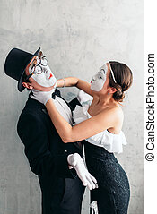 Two pantomime theater artists performing. Mime actors with...