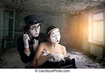 Pantomime theater actor and actress performing. Mime artists...