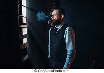Bearded writer in glasses smoking a cigarette - Thoughtful...