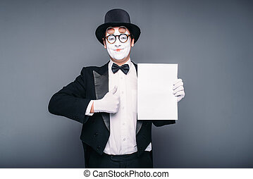 Pantomime actor performing with empty paper sheet. Comedy...