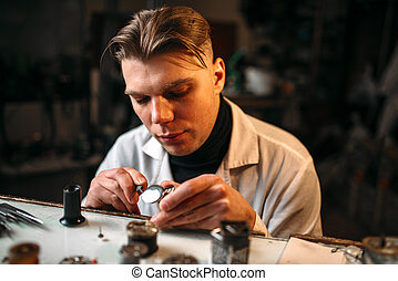 Watchmaker repair broken clockwork with tweezers
