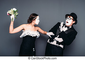 Comedy artists performing with flower bouquet. Mime theater...