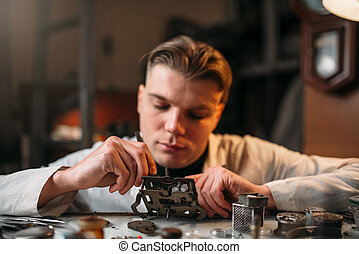 Watchmaker with loupe repair clockwork mechanism
