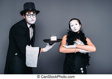 Mime actors performing with a glass of water - Mime actors...