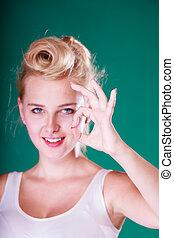 Smiling pin up girl making a ok gesture - Symbols, gestures...