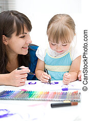 kindergarten - mother and daughter having fun in...