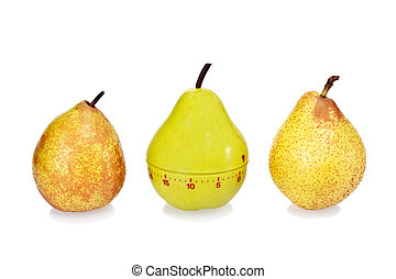Two ripe fresh pears and green plastic pear timer - Two ripe...