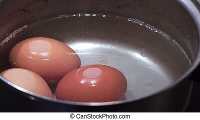 Cooking eggs in a saucepan - The stainless pot boiled...