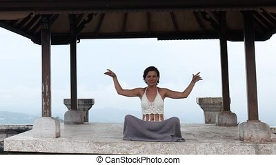 Woman meditating and doing yoga in abandoned temple. Female...