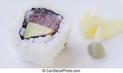Tuna Sushi with Wasabi - Close up of adding wasabi to tuna...