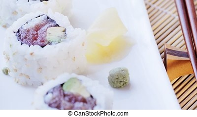 Platter of Tuna Sushi with wasabi - Removing platter with...