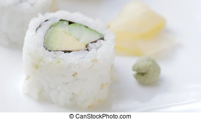 Adding Wasabi to Veggie Roll - Cucumber and avocado uramaki...