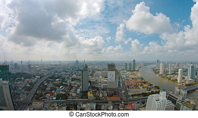 Overlooking view of Bangkok's crowded cityscape, stretching...