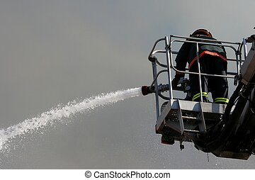 Firefighting - Fireman on an extended boom fighting a fire...