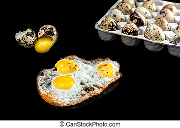 quail eggs in the package,uncooked and broken eggs isolated...