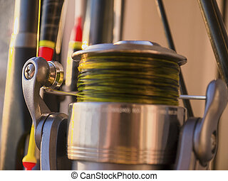 Fishing rod, float and fishing reel close-up