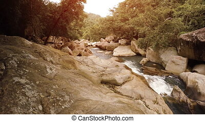 Water Flowing along Rocky River Bed in Vietnam, with Sound