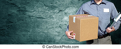 Delivery man with a parcel. - Hands of postman with a box...