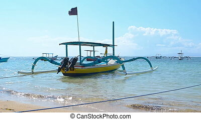 Traditional, passenger boats on popular tourist beach in...