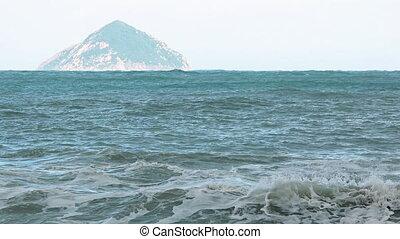 Conical Island Juts from the Sea near Nha Trang, Vietnam. -...