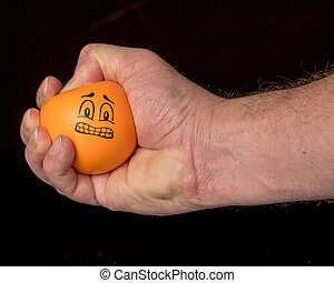Human hand squeezes a stress ball