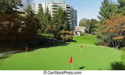 Park backyard area. Golf area with grass - Park backyard...
