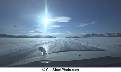 The car is driving along the ice road. View from the window....