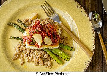 Fresh halibut filet on bed of farro - Fresh halibut fillet...