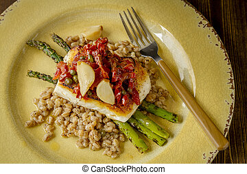 Fresh halibut filet on bed of farro - Shot from above plate...