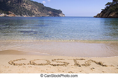 Costa brava beach - Costa written in sand on a nice beach