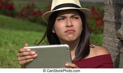 Confused Teen Girl With Tablet