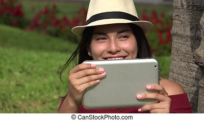 Girl Filming Video With Tablet