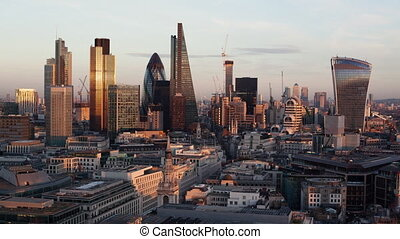 Day to night time-lapse of the business district of London -...