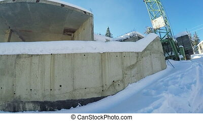 Unfinished brick building in winter - Covered with a thick...