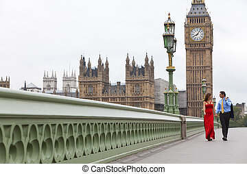 Romantic man and woman couple on Westminster Bridge with Big...