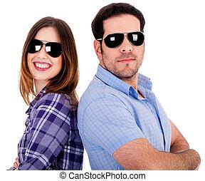 stylish couple posing back to back - closeup of couple...