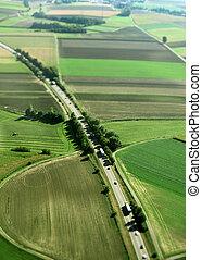 Aerial view of highway between farmlands in Germany.