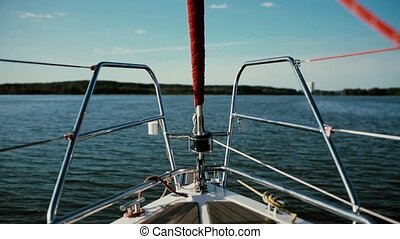 Nasal part of the sailboat goes through the waves with full...