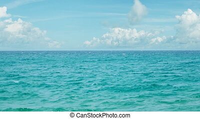 Peaceful Tropical Seascape under a Partly Cloudy Sky. - Tiny...