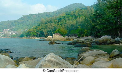 Tranquil Tropical Bay with Boulders and Forested...