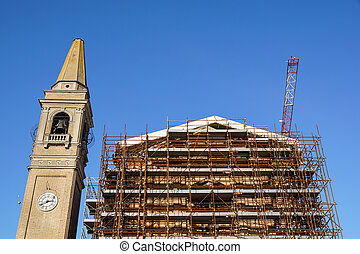 Extensive scaffolding providing platforms for work in...