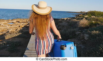 Happy Woman on vacation running with suitcase