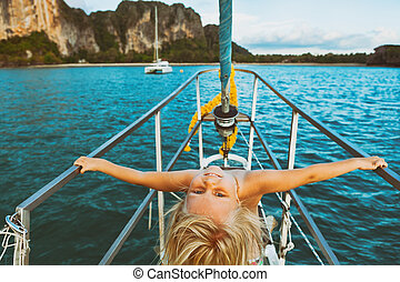 Happy little baby girl on board of sailing yacht - Vintage...