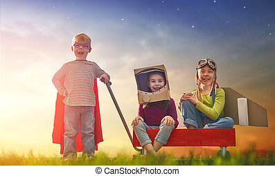 friends games outdoors - Children in astronaut, pilot and...