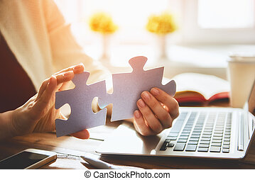 Woman connects couple puzzle piece - Woman is trying to...