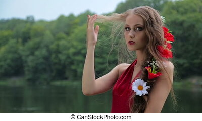 Slow motion shot. Portrait of mysterious girl with creative make-up