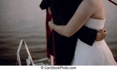 Close-up view of couple bride and groom hugging at the nasal...
